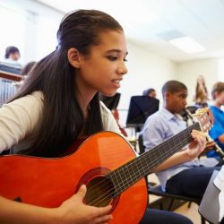 Aws Girl Student Smiling While Playing Guitar