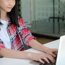 Aws Girl In Plaid Shirt Typing On Laptop